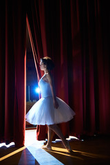 woman as classic dancer looking at stalls before ballet