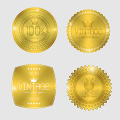 Guarantee of blank round polished gold metal badges on white bac