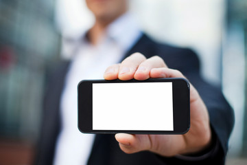 businessman showing smartphone with isolated screen