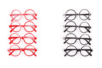 Stack of red and black glasses isolated on white