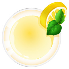 A topview of a glass with a lemon juice