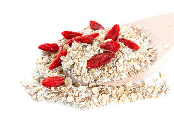 Oat flakes with goji berries on white background