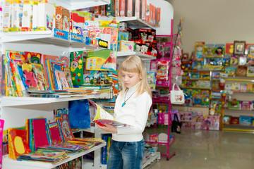 Girl buys school accessories.