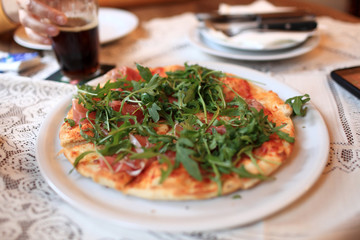 Pizza with meat and arugula