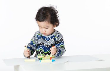 Asian little boy concentrate on drawing