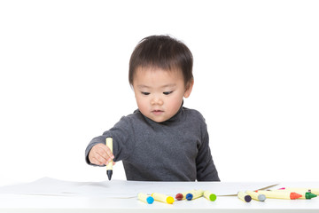 Asian baby boy concentrate on drawing