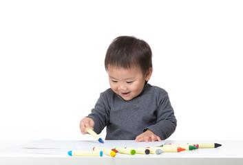 Asian baby boy enjoy drawing