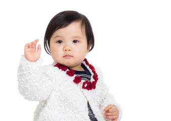 Asia baby girl greeting with hand up