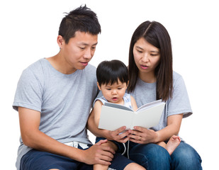 Asian parent reading booking with baby son