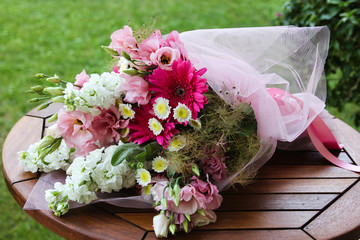 Bouquet of flowers on the wooden table