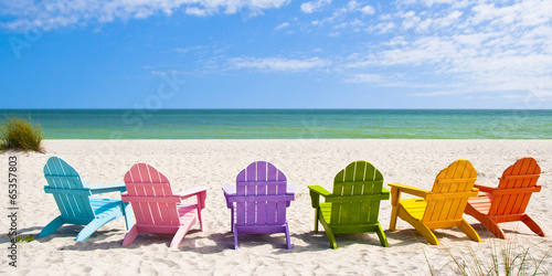 Wall mural Adirondack Beach Chairs on a Sun Beach in front of a Holiday Vac
