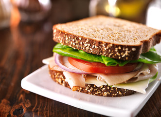 Spoed Fotobehang Snack cold cut turkey sandwich on whole wheat with swiss cheese