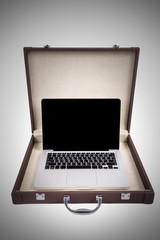Laptop in briefcase isolated on white background (vignette filte