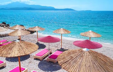 Beach with beach umbrellas