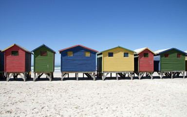 Wooden beach huts in various colours at Muizenberg Western Cape