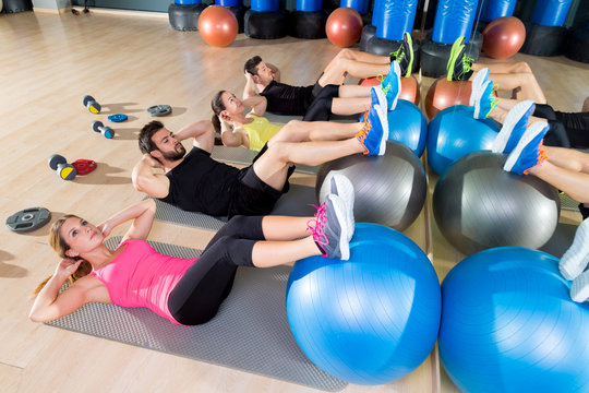 Fitball crunch training group core fitness at gym