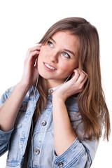 Teenage girl in denim jacket listening to music