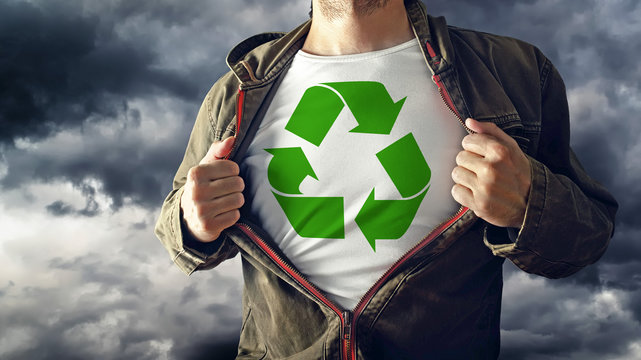 Man stretching jacket to reveal shirt with recycle symbol printe