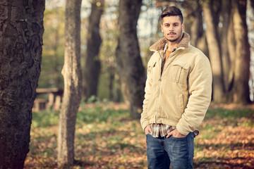 Handsome man in autumn park