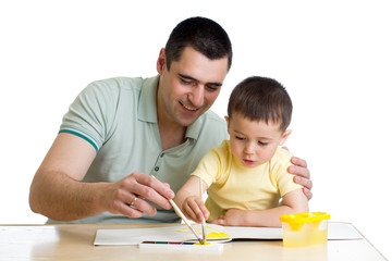 father and kid boy paint together