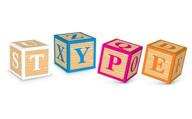 Word TYPE written with alphabet blocks