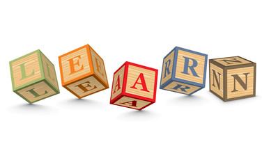 Word LEARN written with alphabet blocks