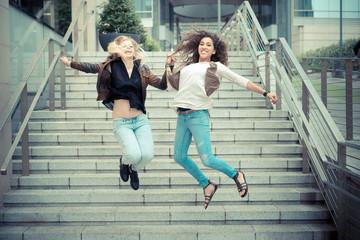blonde and brunette beautiful stylish young women