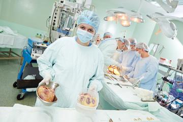 surgeons nurse at cardiac surgery operation