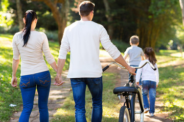 rear view of family walking outdoors