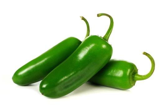 Group of jalapeno peppers isolated on white