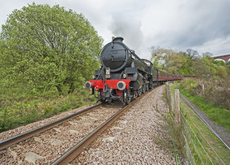 Steam train travelling through countryside