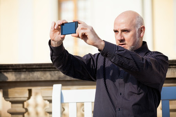 Man taking a photograph with his mobile