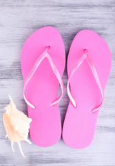 Bright flip-flops on color wooden background