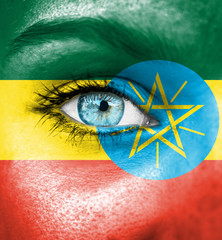 Woman face painted with flag of Ethiopia