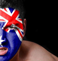 Portrait of angry man with painted flag of Australia