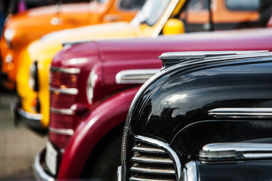 parade of vintage luxury cars