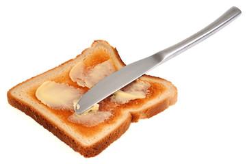 Tranche de pain de mie toasté et beurre
