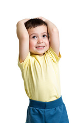 little boy with hands on head over white background