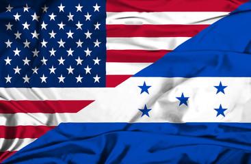 Waving flag of Honduras and USA