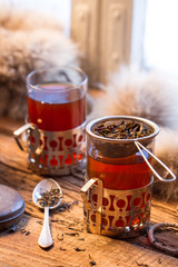 Fototapete - Warming tea served in old-fashioned