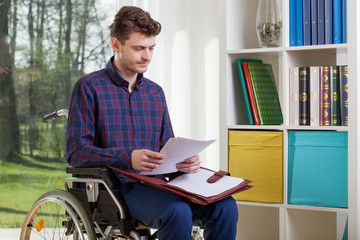 Disabled man viewing documents
