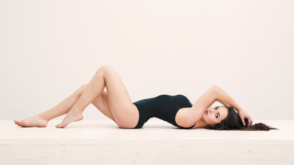 Sensual woman portrait laying on table with black underwear. Ful