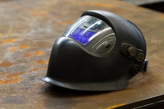 modern welding helmet on table