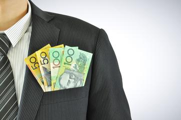 Money in businessman pocket suit - AUD - Australian Dollars