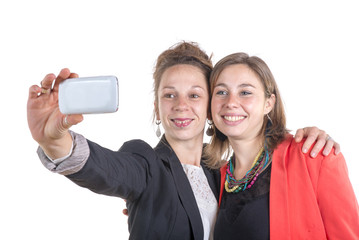two pretty teen girls taking selfies with her smart phone