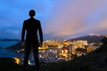 Asian businessman standing in the hill