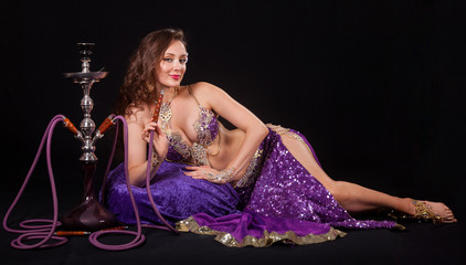 Seductive belly dancer with hookah