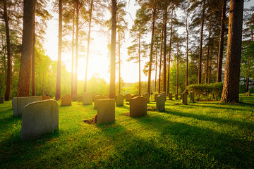 Aluminium Prints Cemetery Graveyard in sunset with warm light