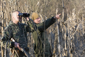 Hunters hunting ducks in wild
