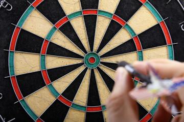 Wall Mural - hand throwing dart to dartboard